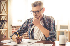 Mature architect working Stock Images
