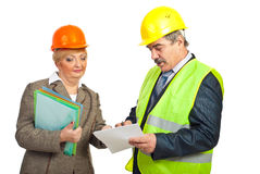 Mature architects team with papers Royalty Free Stock Photography