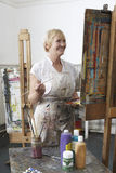 Mature Artist Painting In Art Studio Stock Photos