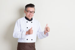 Mature Asian chef thumbs up Royalty Free Stock Photography