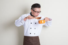 Mature Asian Chinese chef cooking food Stock Photos