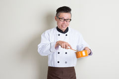 Mature Asian Chinese chef cooking Stock Photo