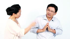 Mature Asian couple arguing. On white screen stock video footage