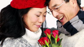 Mature Asian couple holding roses stock video footage