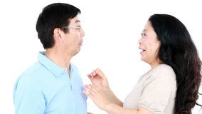 Mature Asian couple telling secrets to each other stock footage