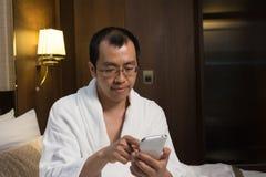 Mature Asian man in bathrobe Stock Photos