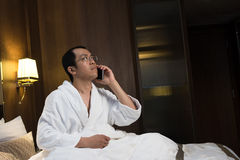 Mature Asian man in bathrobe Royalty Free Stock Photos