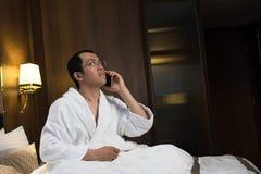 Mature Asian man in bathrobe Royalty Free Stock Photos