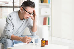 Mature Asian man headache Stock Image