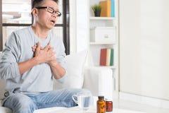 Mature Asian man heart attack Royalty Free Stock Photography