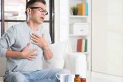 Mature Asian man heartpain Stock Images