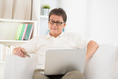 Mature Asian man online purchase Royalty Free Stock Photography