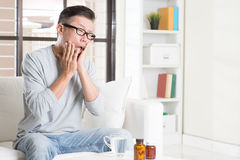Mature Asian man toothache Stock Images