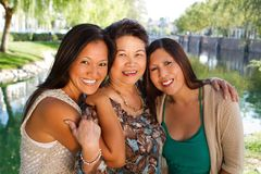 Asian mother and her adult daughters. Royalty Free Stock Image