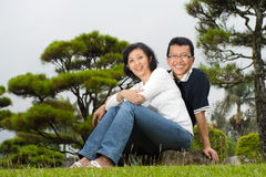 Mature Asian spouse couple. Asian ethnic family portrait of mature couple posing in the park Stock Images