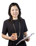 Mature Asian Woman in Business attire with report and coffee cup Royalty Free Stock Photos