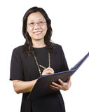 Mature Asian Woman in Business attire with writing tools Royalty Free Stock Photography