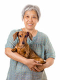 Mature asian woman with dachshund dog Stock Photo
