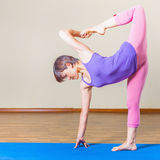 Mature asian woman doing exercise of yoga indoor Stock Photos