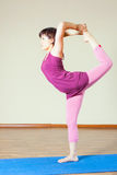 Mature asian woman doing exercise of yoga indoor Royalty Free Stock Image
