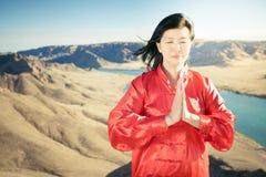 Mature asian woman doing kundalini yoga Royalty Free Stock Image