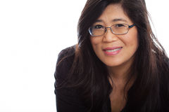 Mature Asian woman in mid forties wearing glasses, smiling Stock Photos