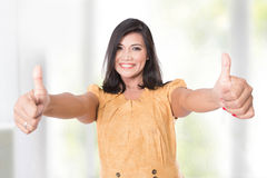 Mature Asian woman posing at the camera showing two thumbs up Stock Image