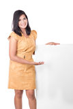 Mature Asian woman presenting a blank white billboard Stock Photos