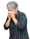 Mature asian woman sneezing Stock Images