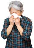 Mature asian woman sneezing Stock Photos