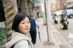 Mature Asian women at street Stock Image