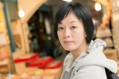 Mature Asian women at street Stock Photography