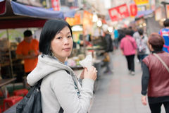 Mature Asian women at street Stock Photo