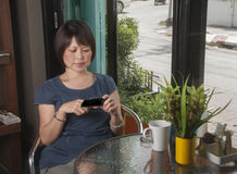 Asian woman with mobile phone Stock Photo