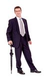 Mature attractive business man with umbrella isolated Royalty Free Stock Photography