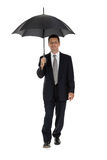 Mature attractive business man with umbrella isolated Royalty Free Stock Images