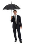Mature attractive business man with umbrella isolated Royalty Free Stock Photos