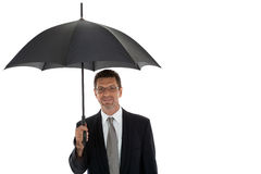 Mature attractive business man with umbrella isolated Royalty Free Stock Image