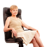 Mature attractive woman in armchair Stock Image