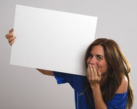 Mature attractive woman with long hair laughs while holding a white sign Stock Photography