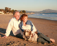 Mature beach couple. Loving mature couple with dog on a California beach Stock Photo