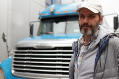 Mature man against truck. Mature bearded man against retro styled truck Stock Photos