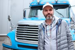 Mature man against truck Royalty Free Stock Photos