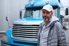 Mature man against truck Stock Photos