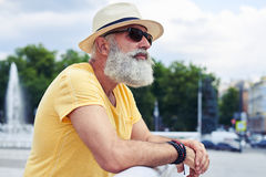 Mature bearded man in sunglasses admiring city panorama Stock Photography