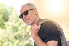 Mature bearded man wearing sunglasses, light effect Royalty Free Stock Photos
