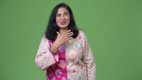 Mature beautiful Indian woman looking shocked stock video footage