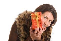 Mature beautiful woman holding gift Royalty Free Stock Photo