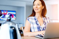 Mature beautiful woman working on her laptop Royalty Free Stock Photos