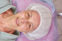 Mature beauty clinic patient smiling. Happy female face top view. Quality health services Stock Photos